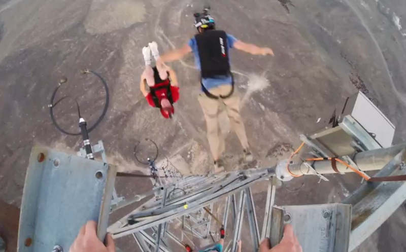 WordlessTech Front Flips Off A Radio Tower - Crazy guy base jumps radio tower