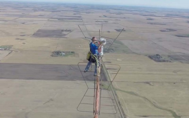 Changing a lightbulb at 1,500 feet