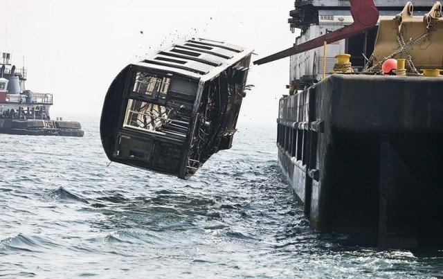 Subway cars are dumped into the sea