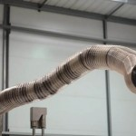 Tesla is developing a Robotic Snake to Charge your car