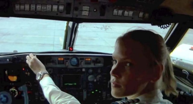 Girl flying a Gulfstream jet