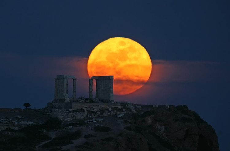 Moon rising over the Temple of Poseidon
