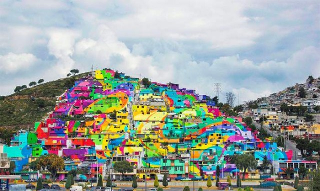 A community at the village of Palmitas decorated by colorful rainbow mural