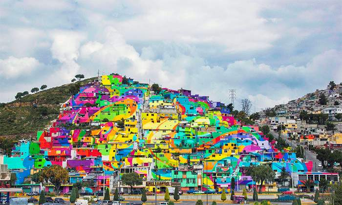 A community at the village of Palmitas decorated by colorful rainbow mural (4)