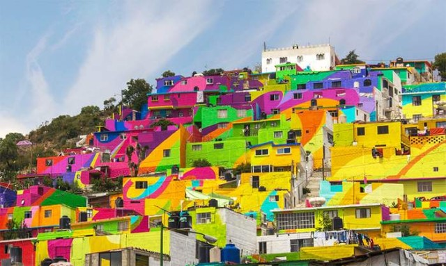 A community at the village of Palmitas decorated by colorful rainbow mural (3)