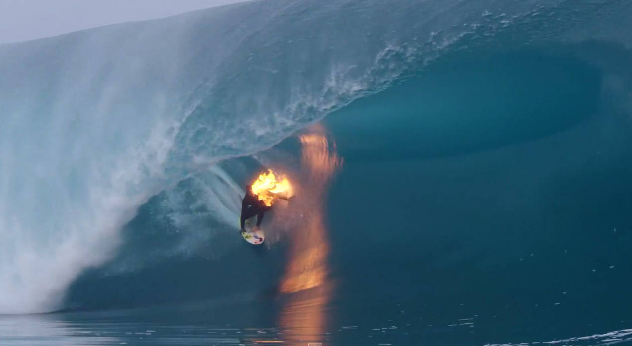 Surfing while he is on fire
