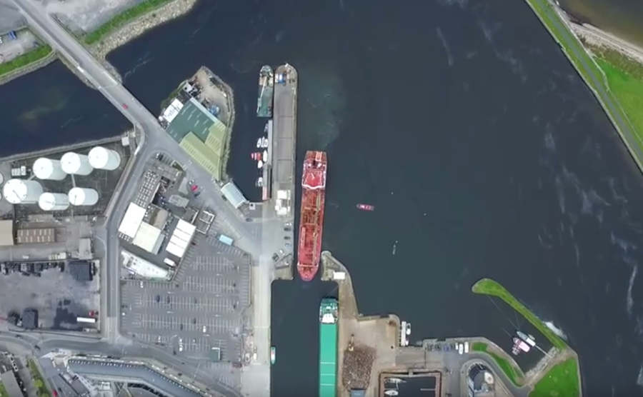 Aerial time-lapse of oil tanker entering a narrow port (1)