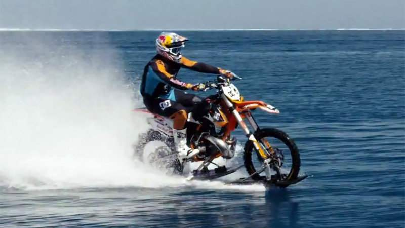 Robbie Maddison rides his dirt bike and surfing (4)