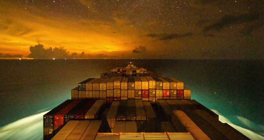 A container ship traveling at night - timelapse