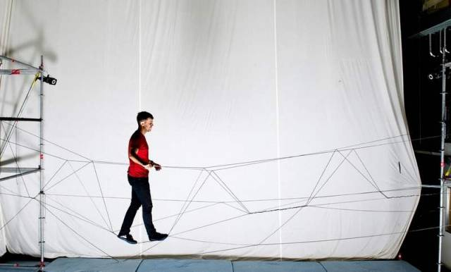 Drones build a walkable rope bridge