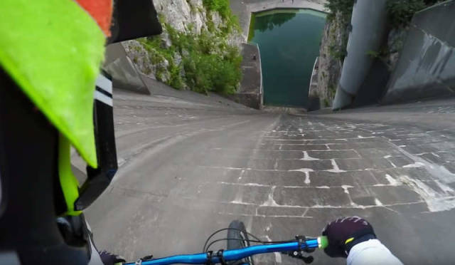 Riding straight down the vertical wall of a dam