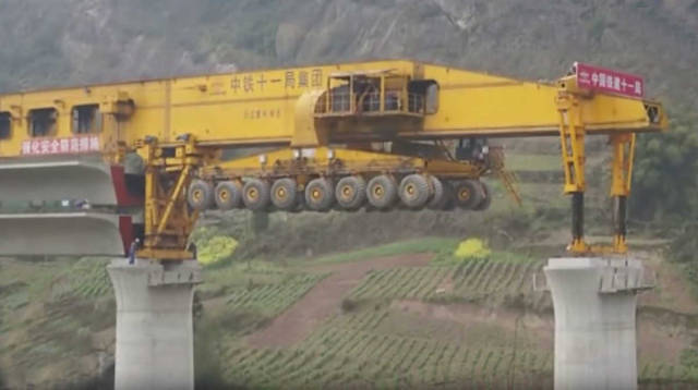 Giant machine building a Bridge