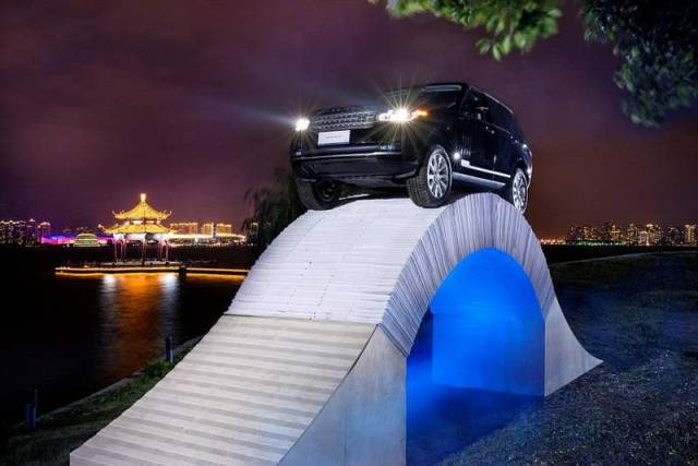 Range Rover drives over a bridge made of Paper