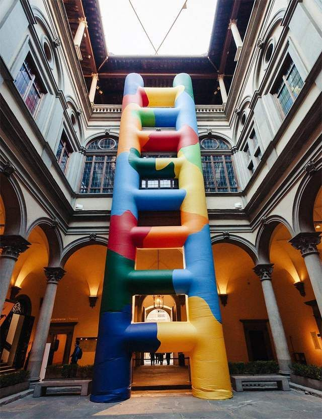 Inflated technicolor ladder within Palazzo Strozzi