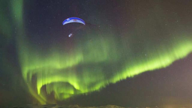 Paraglide Flight Through Aurora Borealis