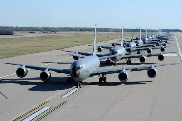 14 KC-135 tankers performing an Elephant Walk