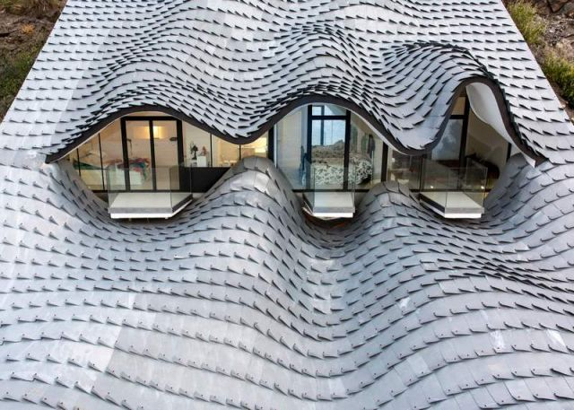 Residence with a wavy zinc-covered roof in Granada province, in Spain (7)