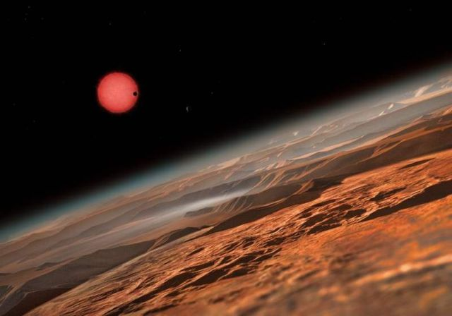 planets is seen in transit across the disc of its tiny and dim parent star