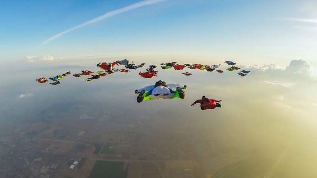 61 Wingsuiters Fly Together