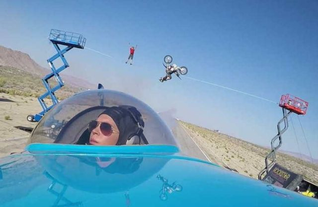 Airplane flies under a Biker doing a Backflip (1)