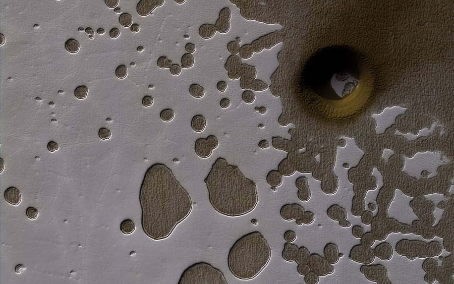 A South Polar Pit or an Impact Crater on Mars