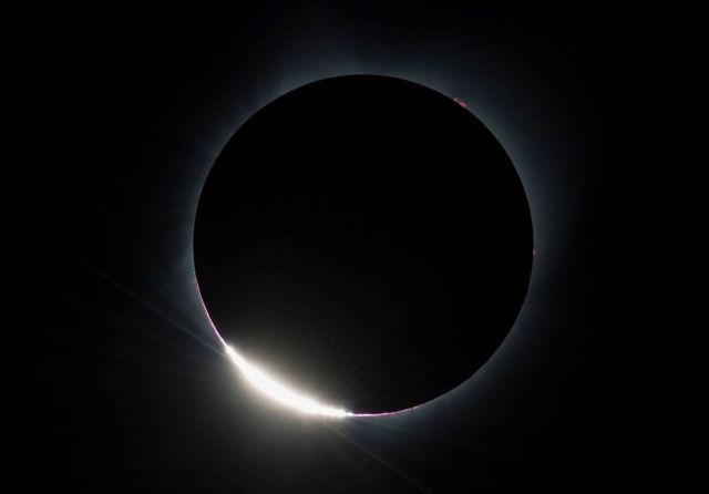 The Diamond Ring effect is seen as the moon makes its final move over the sun during the total solar eclipse