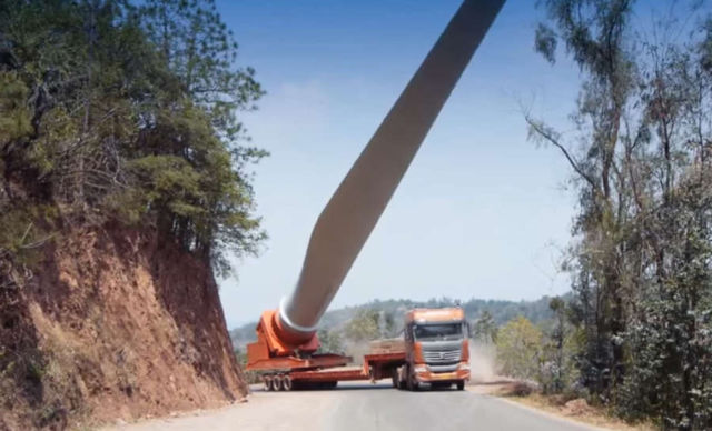 Trucks transporting giant Wind Turbine blades to the mountaintop