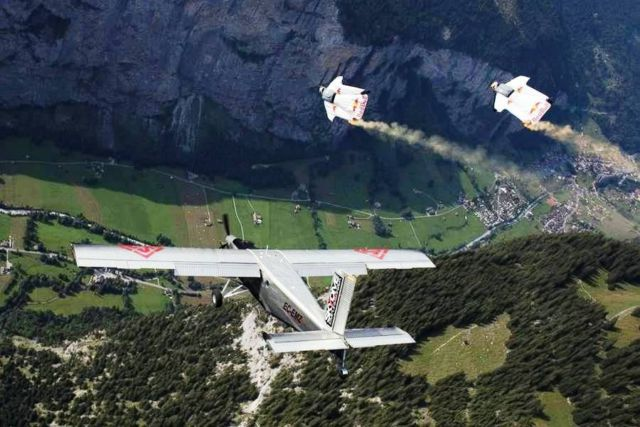 2 wingsuit flyers just BASE jumped into a plane