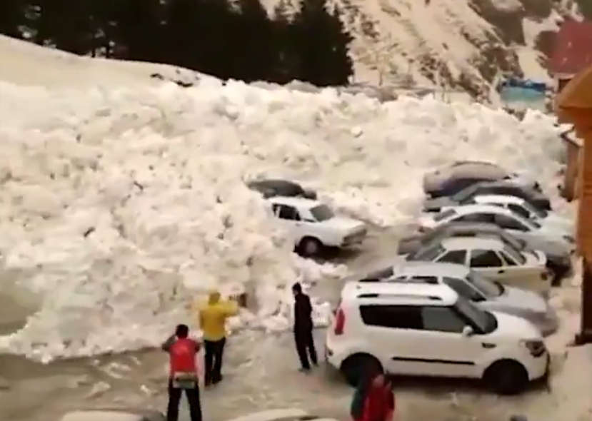 Massive Avalanche swallows cars