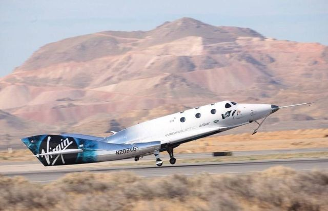 Virgin Galactic spaceplane completes rocket-powered flight (3)