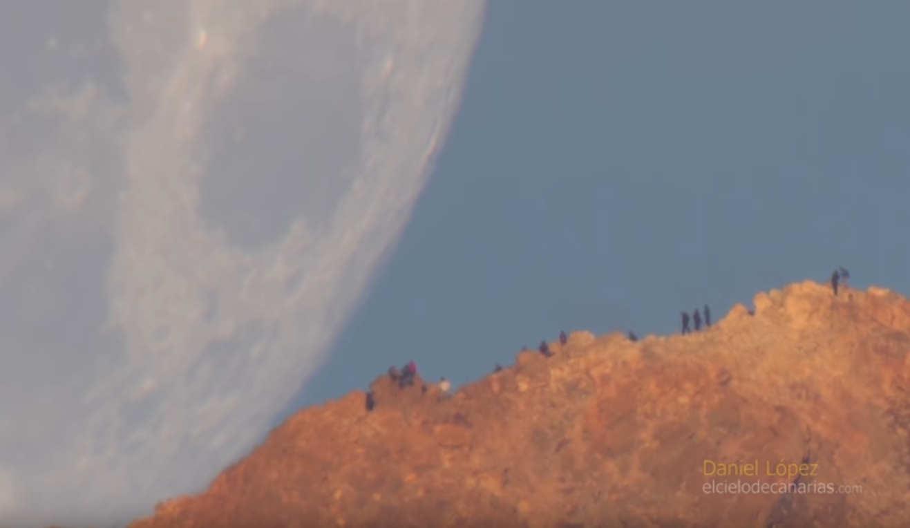 Moon setting behind a Volcano