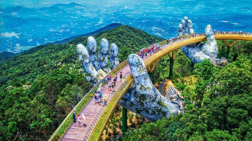 A giant pair of hands supporting a Bridge in Vietnam