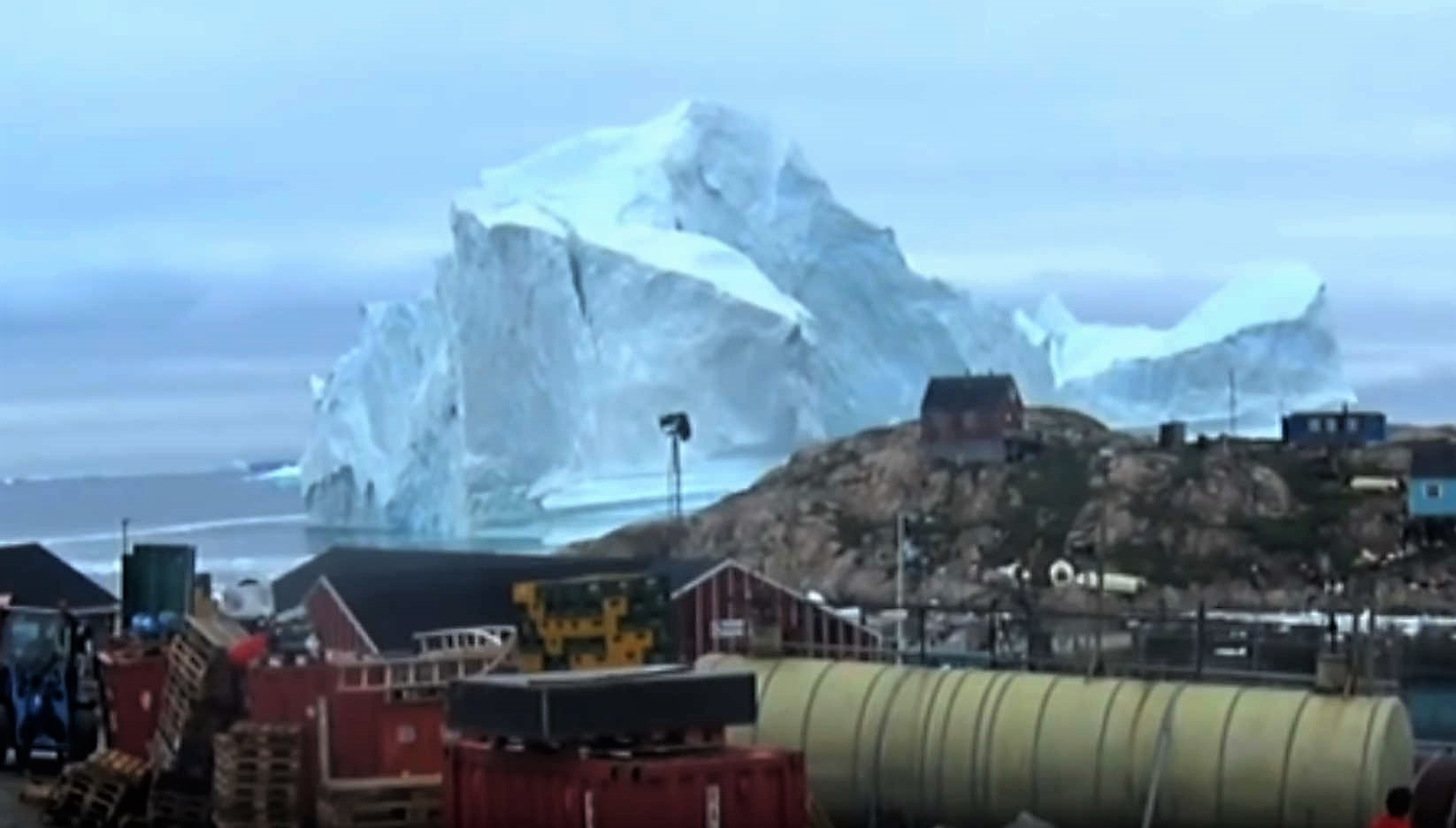 Gigantic Iceberg looms over Greenland village