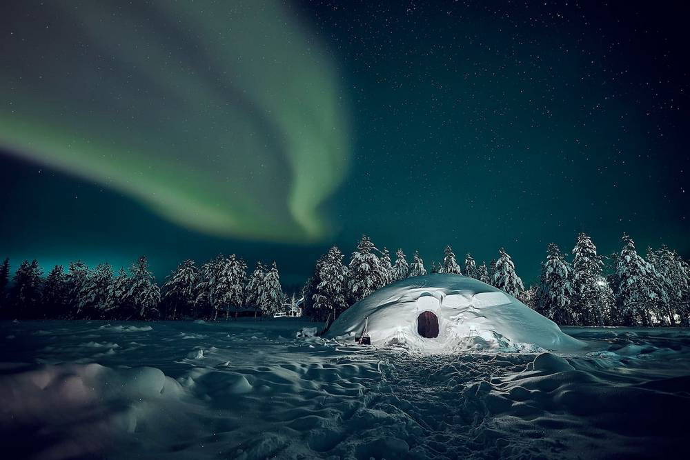 Snow Igloo under the Northern Lights