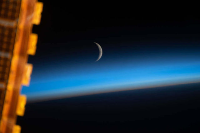 Waxing Crescent Moon Above Earth's Limb