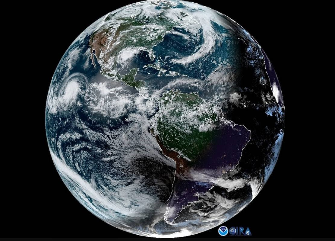 Solar Eclipse 2019- Moon's Shadow and Hurricane seen from Space