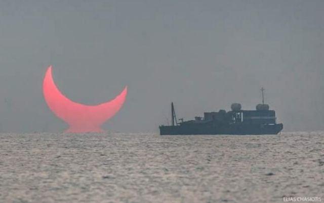 A Distorted Sunrise Eclipse