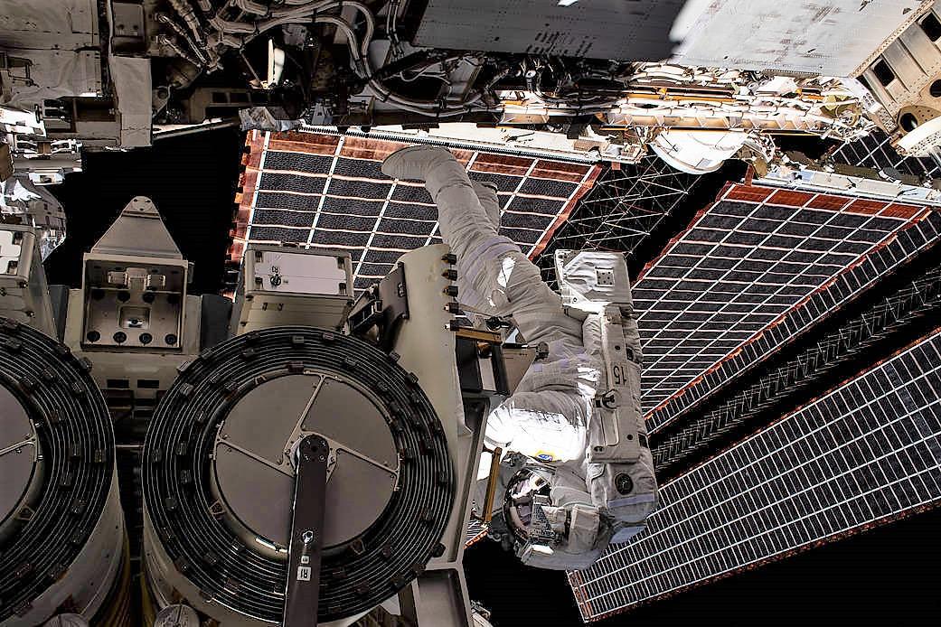 Astronaut installs Solar Array on Space Station